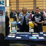 Sierra Nevada University admissions counselors man the booth at a high school college fair.