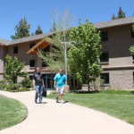 SNU Tahoe 学生们 exit Prim-Schultz dorm hall, which offers students private bathrooms, lounges, and high-speed internet