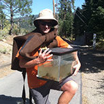 Gus Tjenagel, 科学 major, holding tank with non-native fish to put in Truckee River