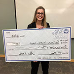 giulianna CRIVELLO, 创业 major, holding check she won at the 商业 Plan Competition