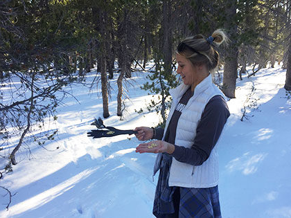 Environmental Systems student feeds Chickadees while on class field trip