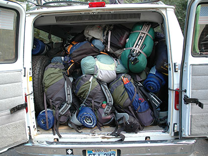 Wilderness Orientation participants load up the SNU Tahoe van with their backpacks filled with gear