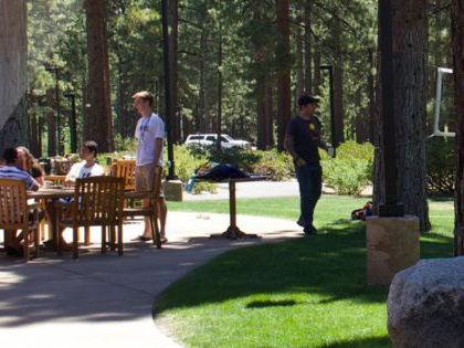 学生们 relax between classes outside Patterson Dining Hall at Sierra Nevada University