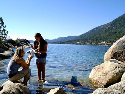 Two Sierra Nevada University science students analyze water samples in Lake Tahoe